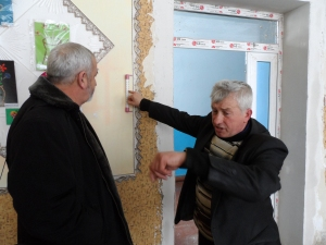 Roman Serba, Manachyn school director, shows that new windows make classes warmer