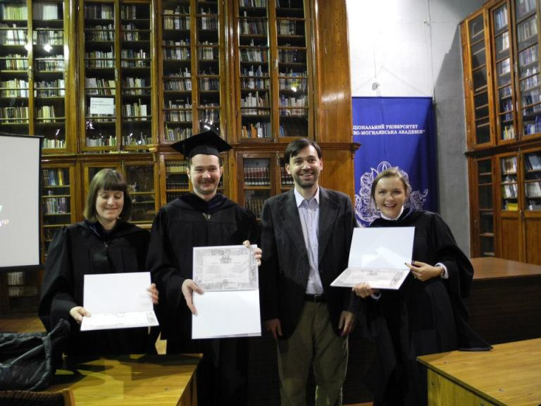 Left to right: PhD student Daria Taradai, PhD student Oleh Ivanov, Head of PhD programme Mass Communications Yevhen Fedchenko, PhD student Anastasia Grynko
